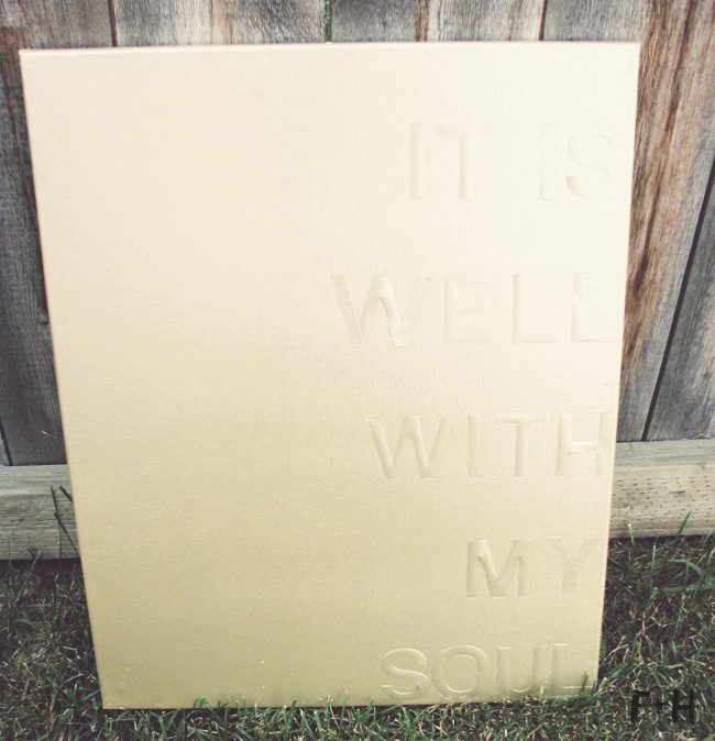gold diy quote canvas leaned against fence