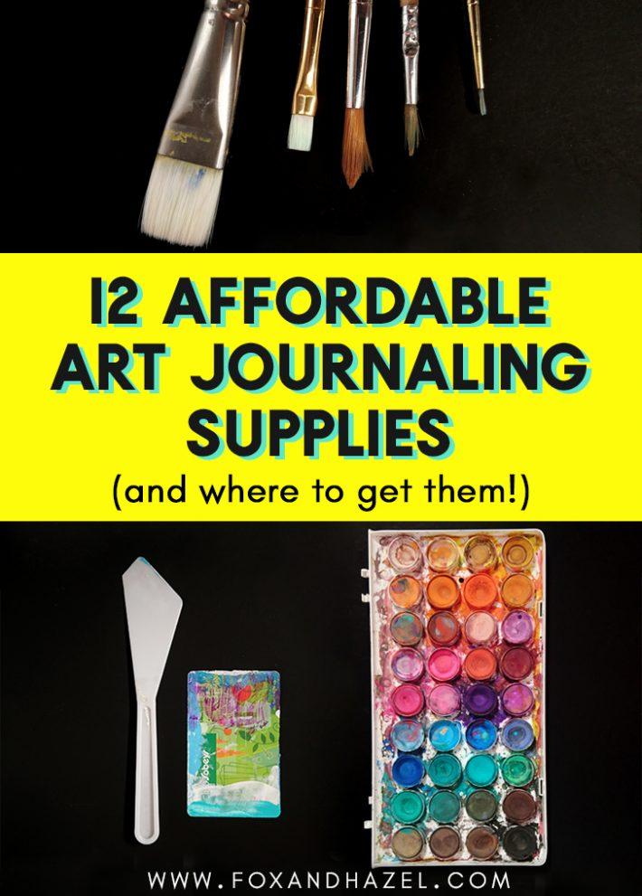 art journal supplies on black background