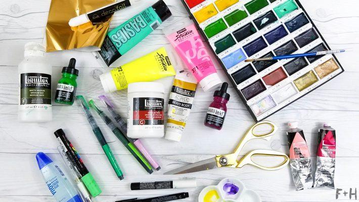 art supplies on white desk