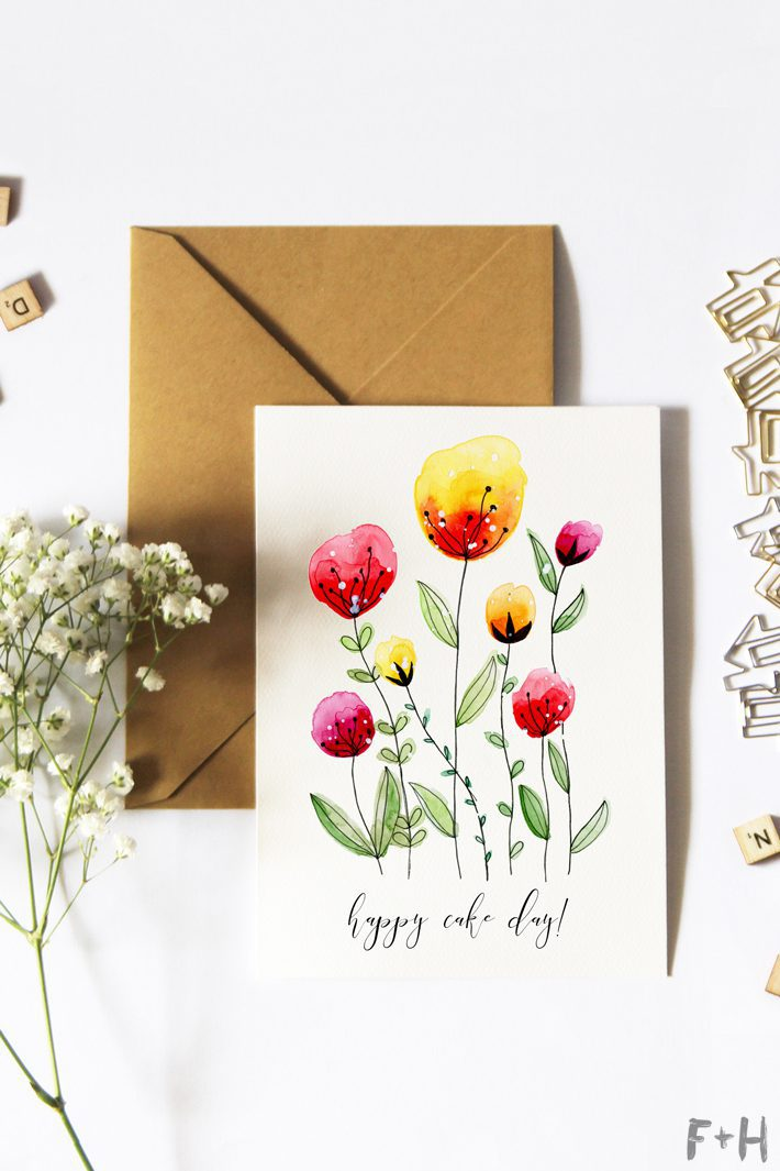 floral watercolor birthday card on flowers on white background