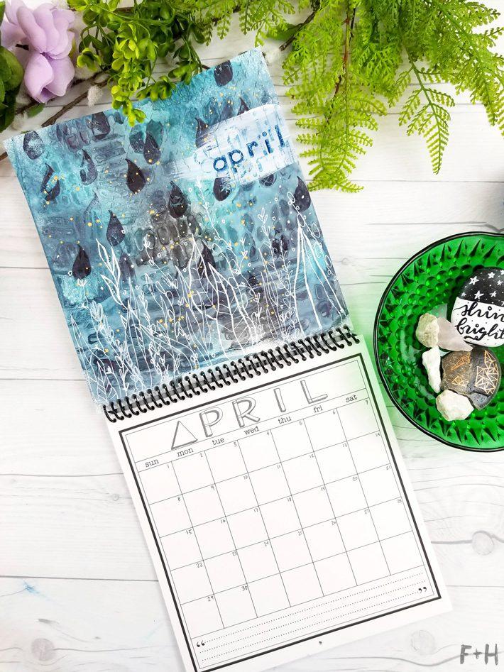 blue mixed media calendar on a white desk