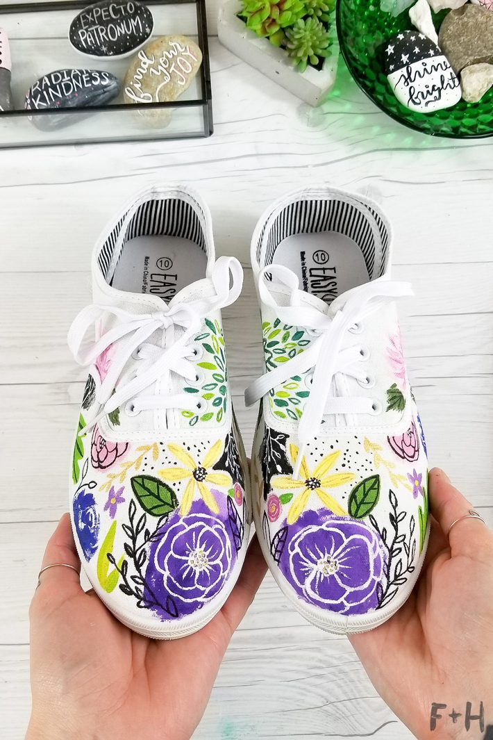 flowers painted on white canvas sneakers