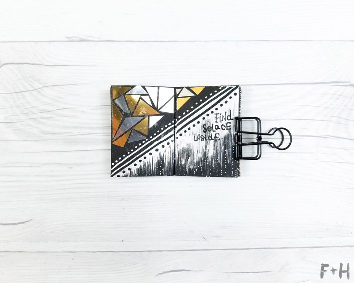 tiny art journal with drawings on white background
