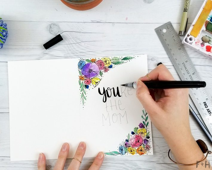 hand lettering with watercolor flowers