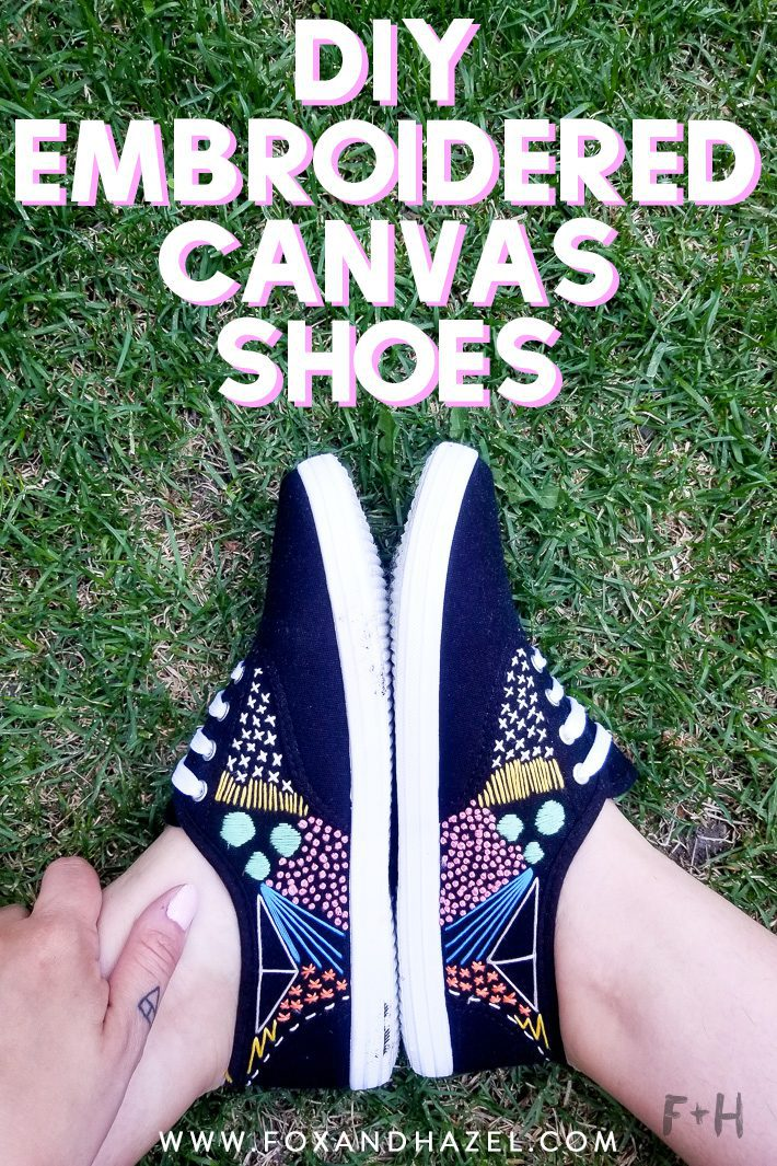 black embroidered canvas shoes on grass