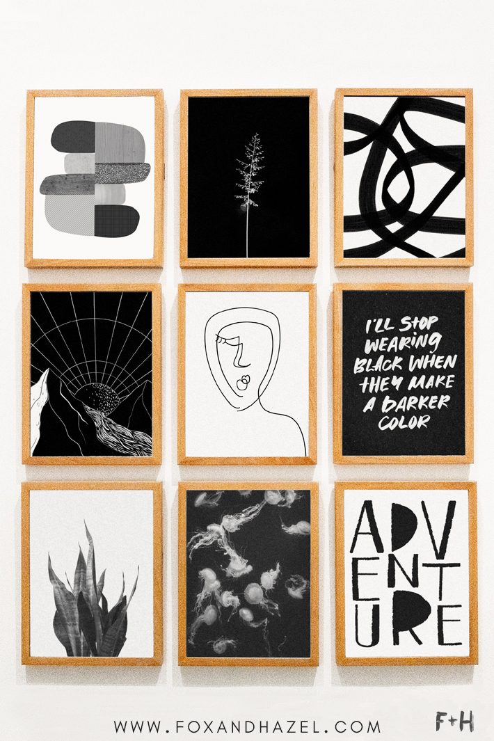 gallery wall of black and white art prints