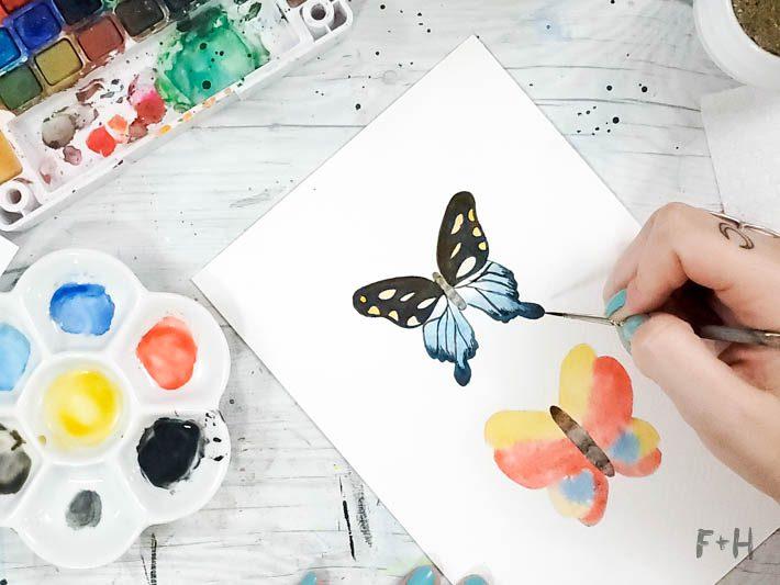 watercolor painted butterflies on desk