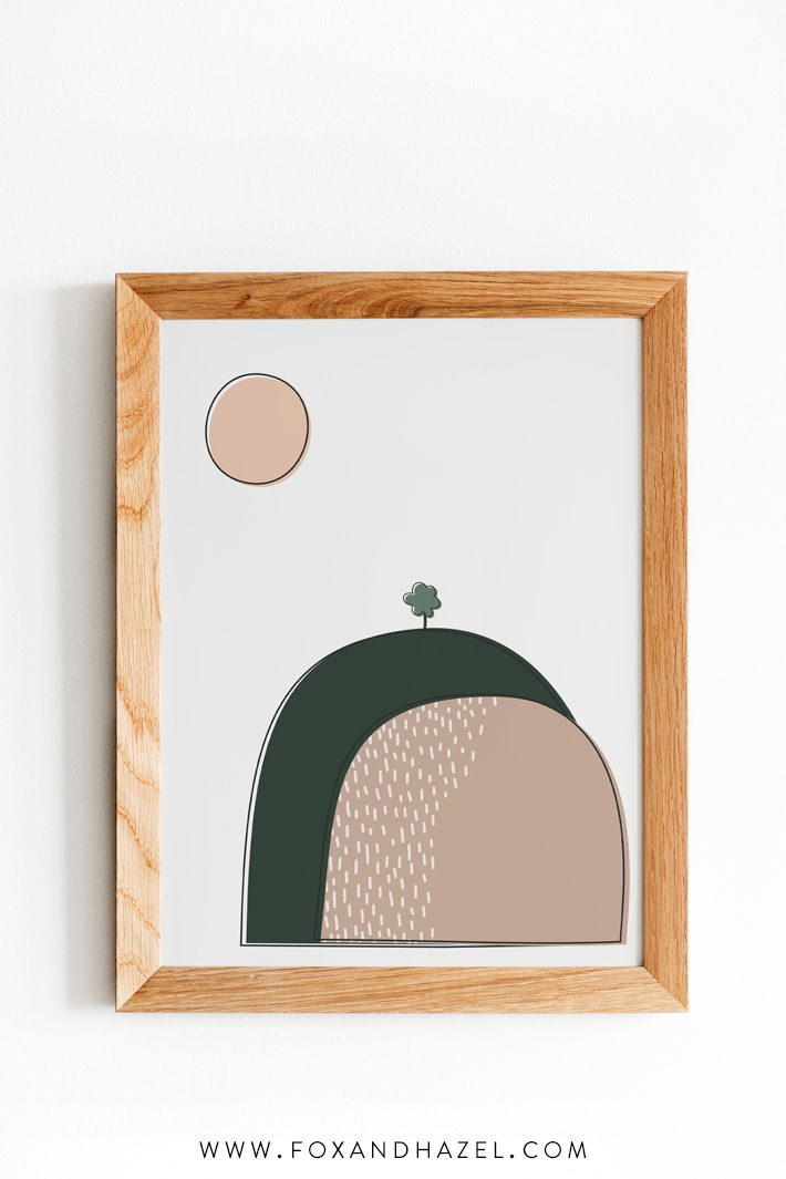 illustration of hills and sun for nursery in wood frame