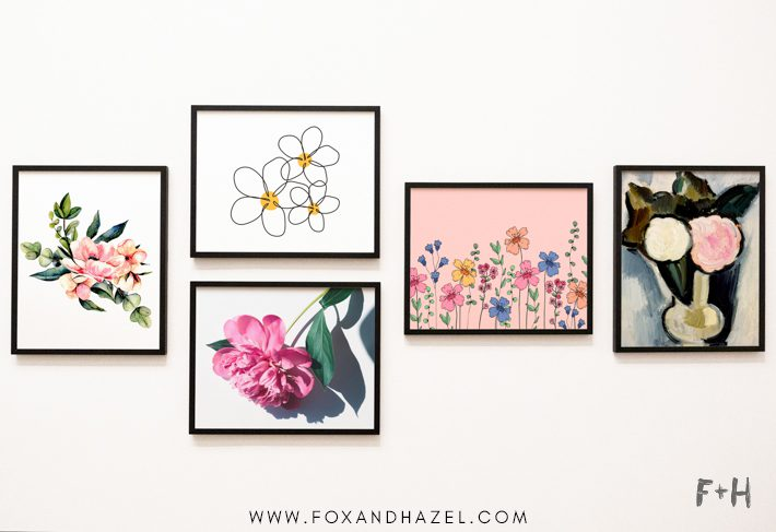 wall of framed floral art prints