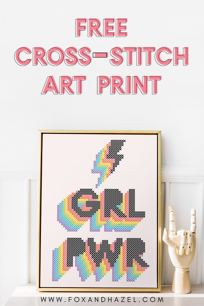 "Framed poster of a cross-stitch inspired art print that reads ""GRL PWR"" in a rainbow design."