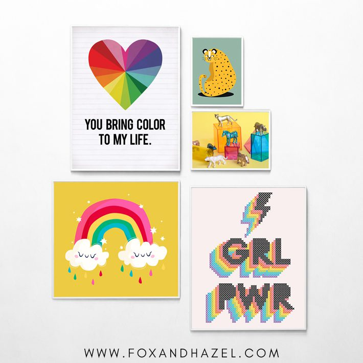 gallery wall of colorful printable wall art for kids in white frames