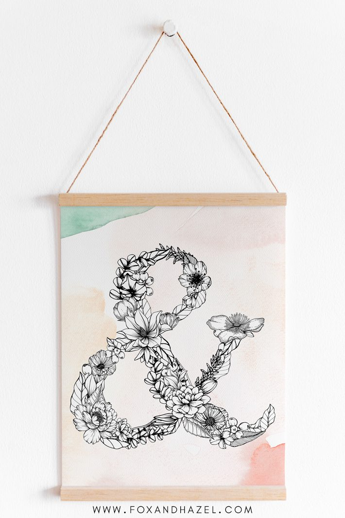 hanging framed art of a floral ampersand printable