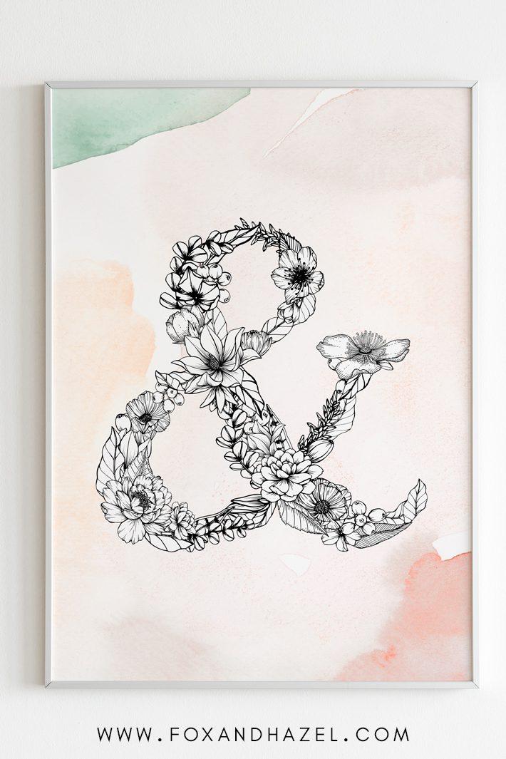 framed floral ampersand artowrk in white frame against white wall