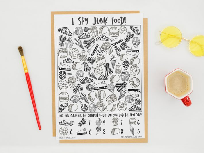 An I Spy activity sheet featuring junk food on a white background, with a paintbrush, cup of coffee and sunglasses surrounding it.