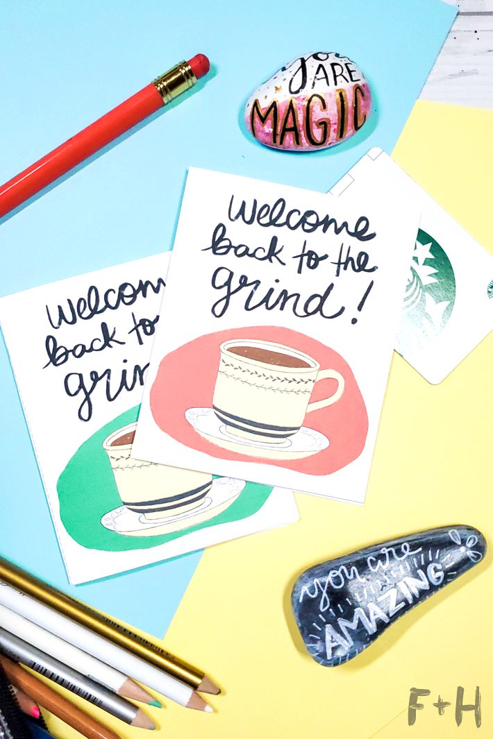 """cards that read """"welcome back to the grind"""" with a hand drawn illustration of a coffee cup on a blue and yellow desk"""
